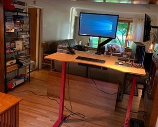 Jarvis Standing desk: As built   but with limited red legs:  https://www.fully.com/standing-desks/jarvis/jarvis-adjustable-height-desk-bamboo.html?campaignid=150471042&adgroupid=28600233522&adid=239083328603&gclid=CjwKCAjwnMTqBRAzEiwAEF3nduDXLloHNig9H5GD2TJgH8WxhuVwTR859WotCLCMI64TcxC3WJf5CBoC27oQAvD_BwE