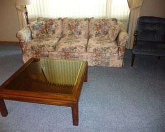 glass top coffee table / small sofa