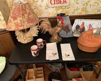 Rooster & Hen Decor(pottery, lamp, tray, linens, cups, table runner and two vintage iron roosters trivets (not pictured). Lamp has red toile shade.
