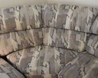 Gray is the trending color in today's decor with this sofa fitting right in.