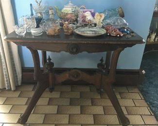 This lamp table has beautiful finials and dates back to the 1800's according to the owner.