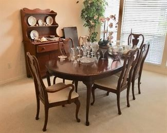 Mahogany stain Fine dining table has extra leaves & early American maple cupboard