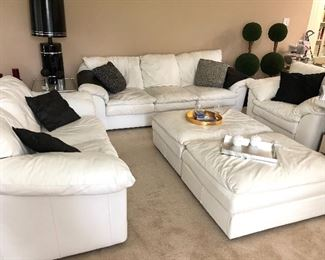 White leather couch, loveseat, chair and two ottomans
