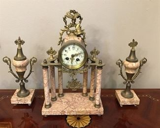 Antique marble clock and side ornaments.