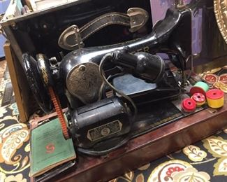 One or three antique sewing machines I have for sale.