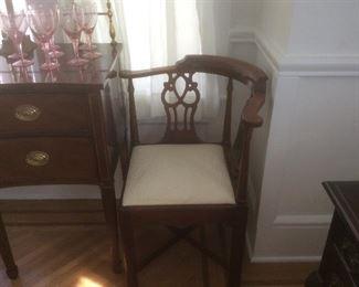 One of pair of corner chairs