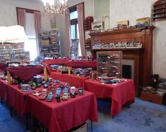 OVERVIEW OF TOY ROOM WITH DIE CAST MODEL CARS BY AUTO ART, MINICHAMPS, PAYA, CORGI & CORGI CLASSICS, WINROSS, SPARK, RIVAROSSI, DANBURY MINT, FRANKLIN MINT AND OTHERS. MODEL TRAINS  BY ROCO, FLEISCHMANN, LILIPUT, ELECTROTRON, BACHMANN & MAGNOS.  MODEL CAR KITS BY RENWAL, MONOGRAM, PYRO, AMT & MORE, OTHER DIE CAST TOYS TOO NUMEROUS TO MENTION.