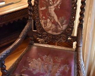 Two antique carved oak armchairs with needlepoint
