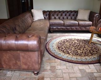 Huge leather sectional sofa. Retailed for around $8,000