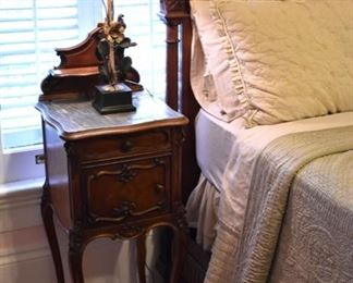 Lovely pair of French walnut and marble nightstands
