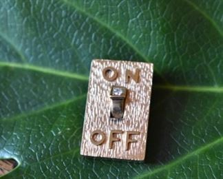 """18K and diamond """"On/Off Switch"""" charm"""