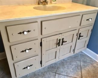 There are two bathrooms with vanities, sinks, faucets, mirrors