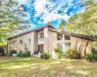 """This 1970's style house is on the same property & is also being salvaged....but everything is """"as is"""" and dated."""