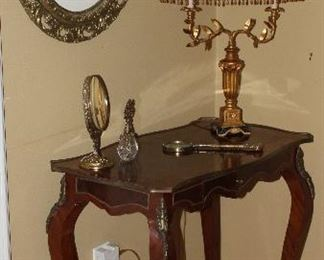"French Ladies' Writing Desk with Ormolu Brass Mounts and Center Drawer. Also shown is a Vintage Italian Florentine 2 Arm Table Lamp and an Antique Gold Gilt Oval Framed Louis Icart ""Le Bonnet Blue"" Print"