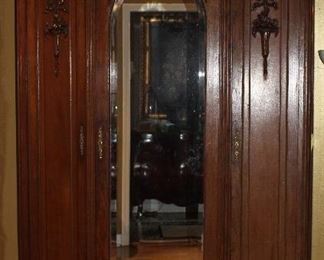 "Antique 1880's French Louis XVI  3-Door Armoire, with  Arched Bevel Mirror Center Door.  Arched Crown with Applied decorations and Finial Corners. (95""W x 56""W x 18.5""D)"