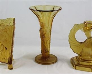 "Walter & Sohne West Germany Rare Art Deco Amber Glass Collection:  Triangle Footed Vase (7""H x5 1/4""W), Trumpet Style Vase (9.5""H x 5.5""W). Dancing Girl Candlestick (7,5""H x 6.5"")"