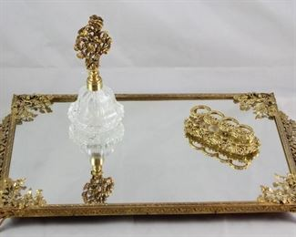 "Hollywood Regency Mid Century Gold Plated Rectangular Vanity Mirror, Crystal Perfume with Gold Plated Floral Glass Dauber Stopper and ""The Buckles"" Lipstick Holder."