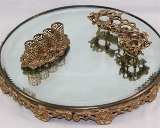 Antique Bevel Mirror  Plateau Footed  Tray Shown with Hollywood Regency Mid Century Gold Plated Filigree Lipstick Holdes