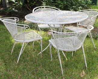Vintage Mid Century Wrought Iron Mesh Table and 4 Barrel Back Chairs