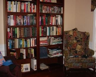Several bookcases, and many books, lots of newer novels as well as older books