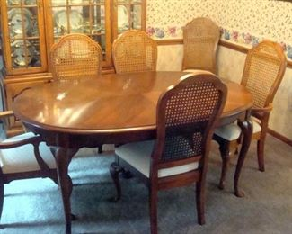 Thomasville dining table with two leaves and six Thomasville chairs.