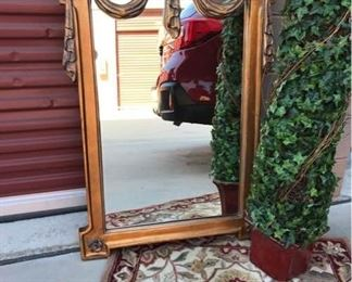 Mirror, Rug, and Topiary