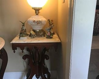 One of a pair of marble top tables and GWTW lamp, bird figurines by Andrea