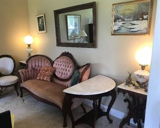 Antiques in living room:  Victorian sofa with  tufted back and arms, Deni Line marble top console table, two small marble top tables, snow painting by Margaret Jones (Ted Jones grandmother)GWTW lamps
