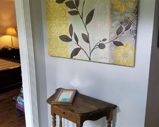 Cute vintage console table and large, colorful canvas.