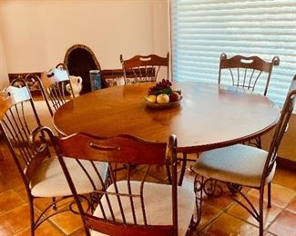 Round dining table with six chairs