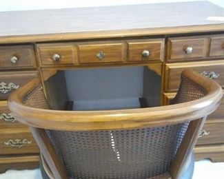 Desk with storage and wicker back chair.https://ctbids.com/#!/description/share/212880