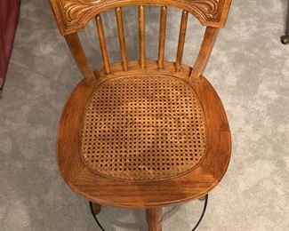 TWO PRESS WOOD CANE SEATED BISTRO STOOLS.