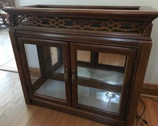 Beautiful Curio with Beveled Glass and Lighting to show off your collectables