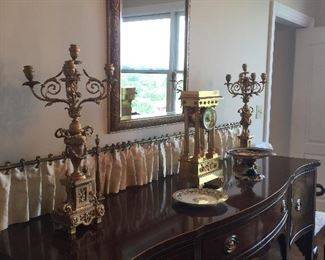 Kittinger sideboard with brass rail   Pair gilt bronze candelabras.  Gilt bronze clock.