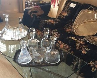 Assorted silver-plate and bottles.