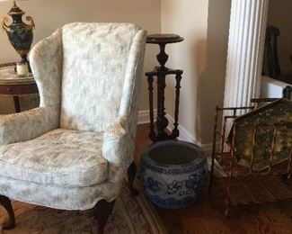 Several chinese fish bowls and very nice upholstered pieces.
