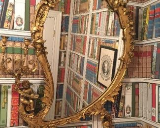Gilt wood and gesso antique mirror.
