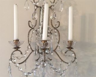 Pair crystal and mirror sconces.