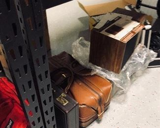 leather carry on bag,pair of Bose speakers