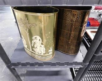 2 Assorted  oval themed metal waste cans