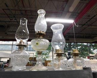 Assorted antique hurricane lamps