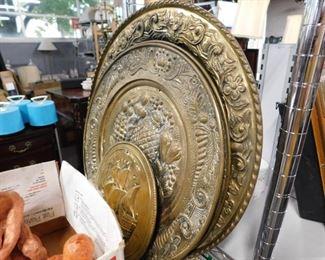 Assorted brass wall decor