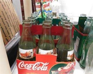 Assorted Coca Cola bottles
