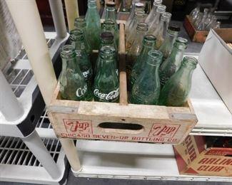 Assorted Coca Cola bottles  Vintage 7up wooden crate