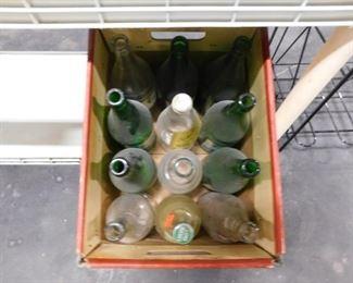 Assorted vintage soda bottles