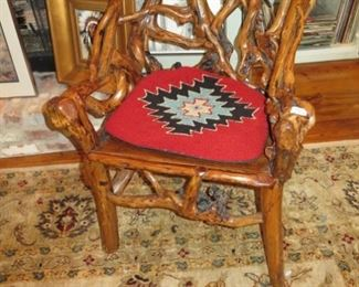fabulous wisted cypress chair, rug, lots of art in background
