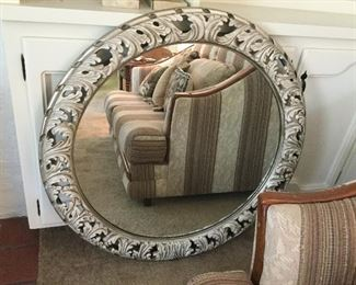 Round wall mirror in cast metal