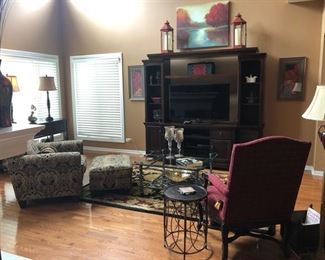 """Here's the Great Room - with the Flexsteel chair and ottoman on the left, the 3-pc. media unit and the 46"""" Samsung HDTV,  Great Nourison Rug, Coffee Table, prints and original art  on the walls, lamps, tables and the Drexel-Heritage chair to the right."""