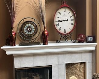 """The clock is a reproduction of an old French clock, metal and sitting on a very large easel.  It's hard to get the scale of these items.  The clock itself is about 28"""" tall, plus the easel."""