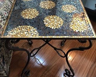 This is a very sweet mosaic table